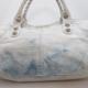 Вам нужно почистить сумку из белой кожи?