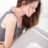 почему болит живот после месячных
