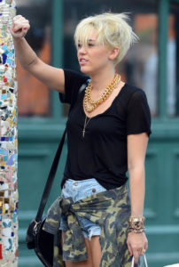 Miley Cyrus shops on Saint Mark's Place in the East Village with her friend and assistant, Cheyne Thomas . Pictured: Miley Cyrus Ref: SPL428331 230812 Picture by: Wylde / Splash News Splash News and Pictures Los Angeles: 310-821-2666 New York: 212-619-2666 London: 870-934-2666 photodesk@splashnews.com
